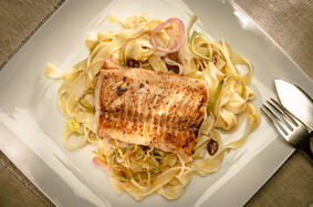 Wild salmon fillets with tagliatelle in a white wine sauce