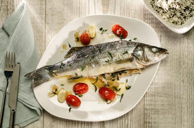 Baked seabass with lemon and tarragon sauce